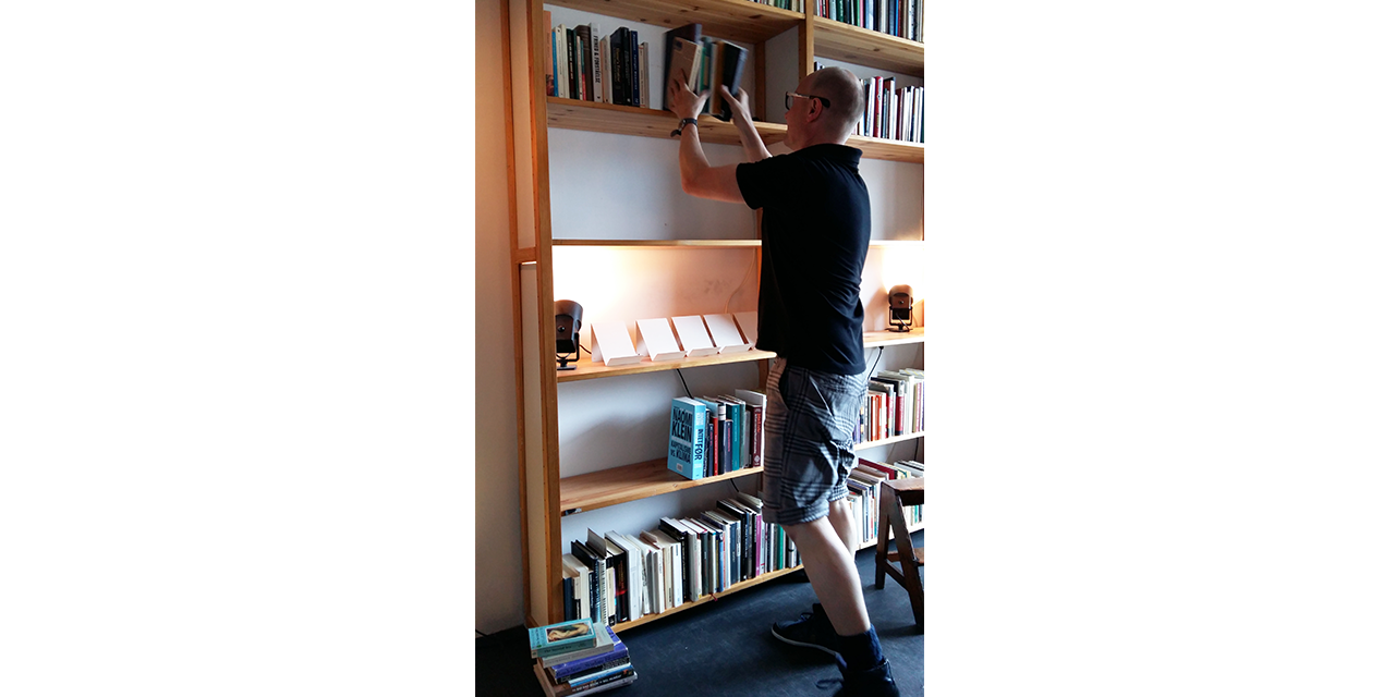 Tommy clearing shelves for our books